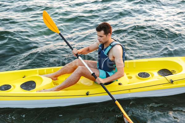 Férfi kajak kaland utazás tevékenység életstílus Stock fotó © deandrobot