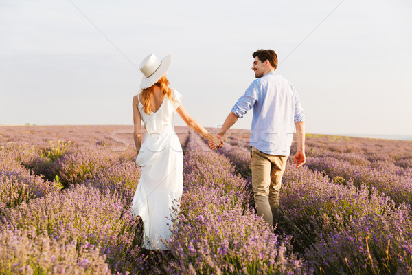 Back view cheery young couple at the lavender field Stock photo © deandrobot