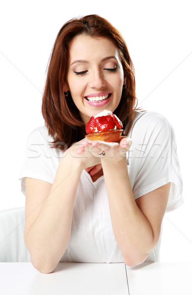 Smiling woman sitting at the table and holding fresh strawberry cake isolated on a white background Stock photo © deandrobot