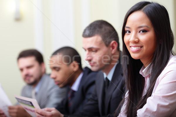 Többnemzetiségű üzlet cégvezetők dolgozik iratok fókusz Stock fotó © deandrobot