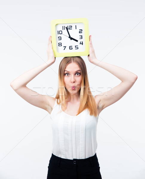 Young woman holding big clock Stock photo © deandrobot