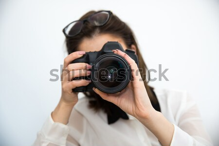 Woman photographer with camera over gray background Stock photo © deandrobot