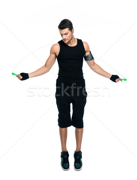 Fitness man jumping with skipping rope Stock photo © deandrobot