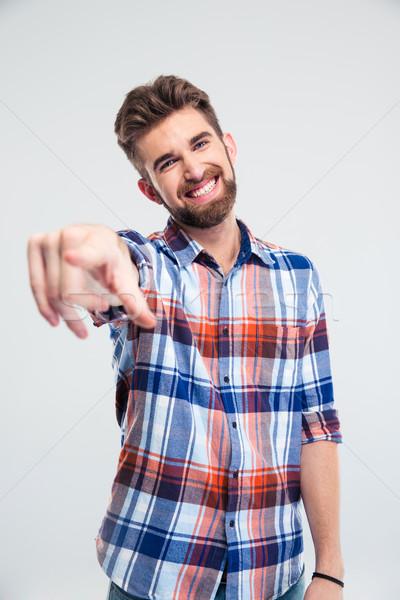Happy man pointing finger at camera Stock photo © deandrobot