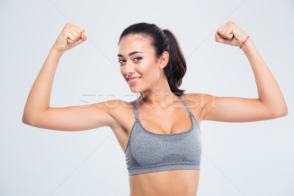 Fitness woman showing her biceps Stock photo © deandrobot