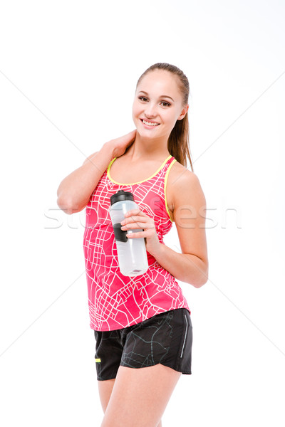 Young woman with bottle of water Stock photo © deandrobot