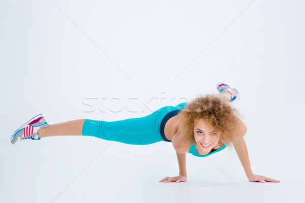 Fitness woman doing handstand exercise Stock photo © deandrobot