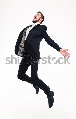 Excited elated happy young business man jumping and shouting Stock photo © deandrobot