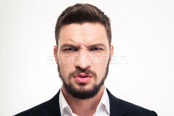 Close up of angry irritated bearded business man looking camera Stock photo © deandrobot
