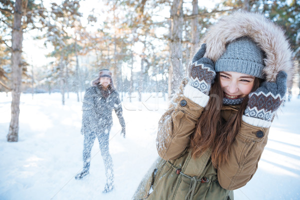 Happy young couple playing snowballs outdoors Stock photo © deandrobot