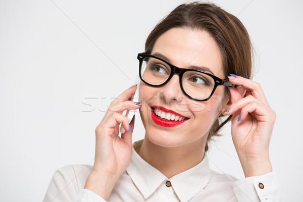 довольно деловой женщины очки говорить сотового телефона Сток-фото © deandrobot