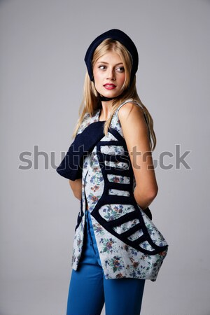 Beautiful young woman standing with hands on waist Stock photo © deandrobot