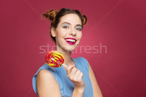 Güzel genç kadın gülen lolipop Stok fotoğraf © deandrobot