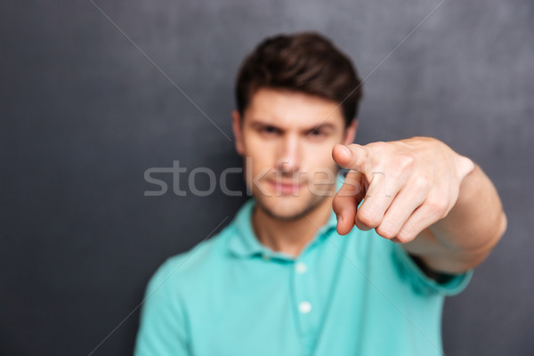портрет человека указывая пальца камеры Сток-фото © deandrobot