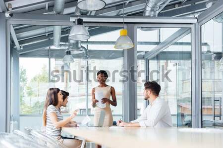 Businesspeople talking and working together in conference room Stock photo © deandrobot