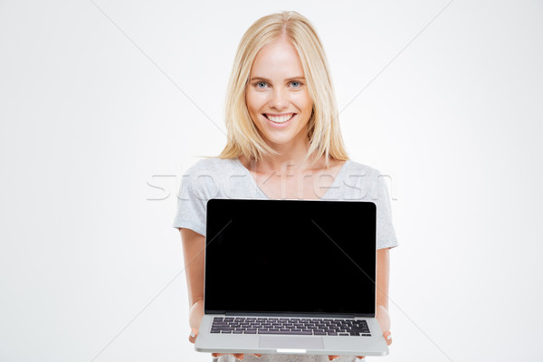 Sorridente mulher loira computador portátil tela isolado Foto stock © deandrobot