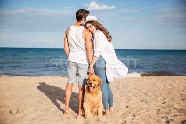 Couple spending time together on the beach with their dog Stock photo © deandrobot