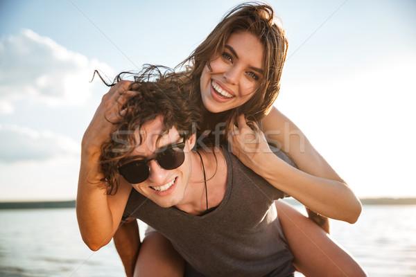 小さな 幸せ カップル ピギーバック ビーチ 笑みを浮かべて ストックフォト © deandrobot