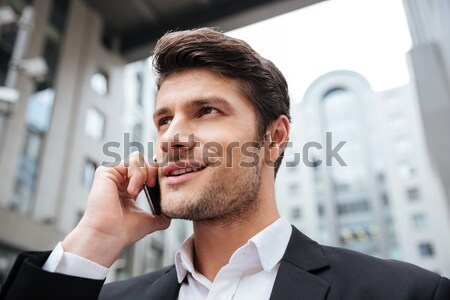 Businessman talking on mobile phone in the city Stock photo © deandrobot