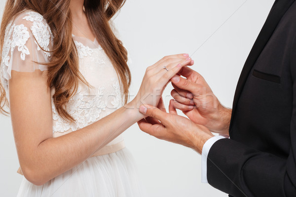 Man giving an engagement ring to his woman Stock photo © deandrobot