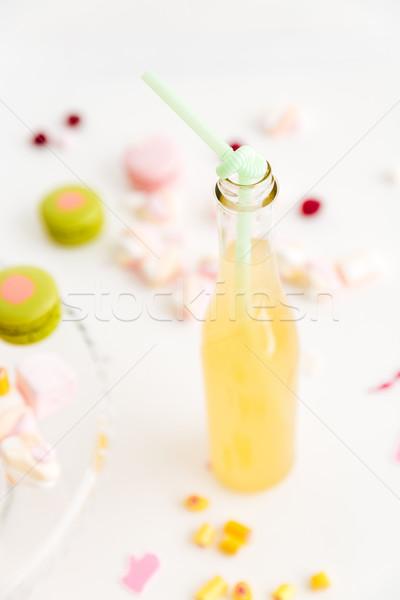 коктейль бутылку соломы таблице конфеты Сток-фото © deandrobot