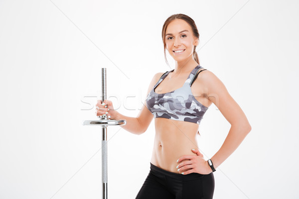 Smiling fitness girl with barbell Stock photo © deandrobot