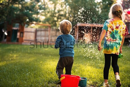 Dzieci boisko chłopca dziewczyna rozmycie gry Zdjęcia stock © deandrobot