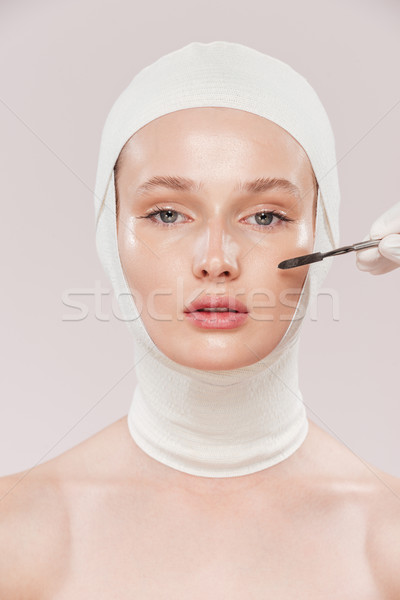 Unusual photo of model with brush Stock photo © deandrobot