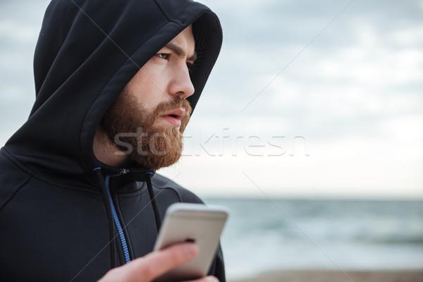 Runner telefono spiaggia profilo uomo cross Foto d'archivio © deandrobot