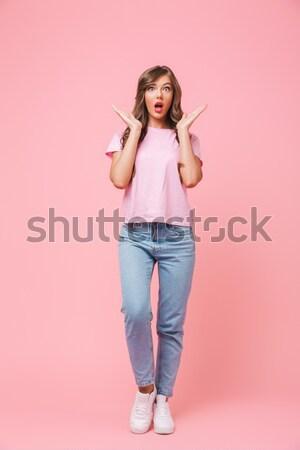 Játékos hölgy tart cukorka falat ajak Stock fotó © deandrobot