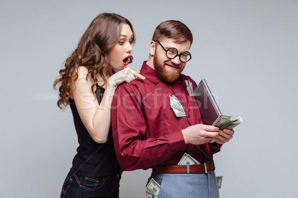 Schockiert Mädchen zurück männlich nerd Geld Stock foto © deandrobot