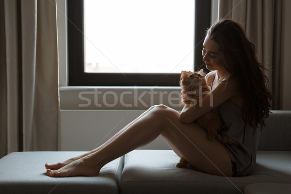 Side view of woman in nightie with cat Stock photo © deandrobot