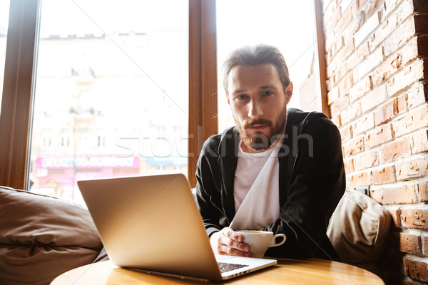Serious Bearded man in cafe near the window Stock photo © deandrobot