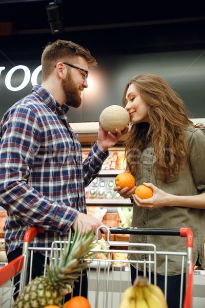Pionowy obraz człowiek zapach melon kobieta Zdjęcia stock © deandrobot