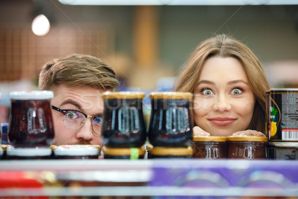 Couple looking camera hiding near marmelade Stock photo © deandrobot