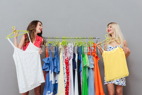 Two women choosing clothes near the rack Stock photo © deandrobot