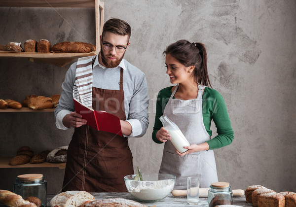 Couple reading recipe of bread Stock photo © deandrobot