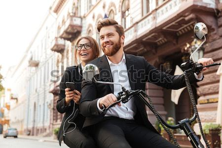 Smiling stylish couple rides on modern motorbike Stock photo © deandrobot