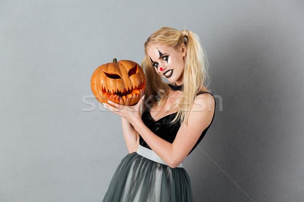 Boldog derűs szőke nő halloween bohóc smink Stock fotó © deandrobot