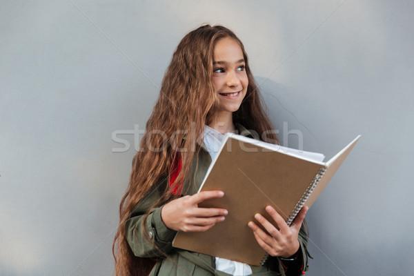 счастливым брюнетка школьница длинные волосы одежды Сток-фото © deandrobot
