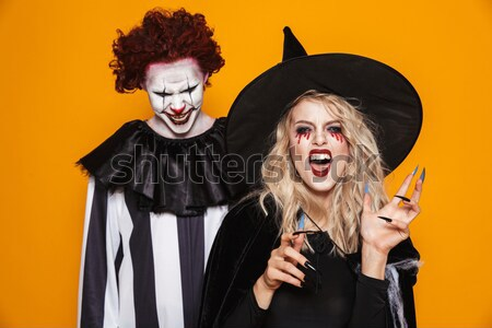 Emotional young woman in halloween costume Stock photo © deandrobot