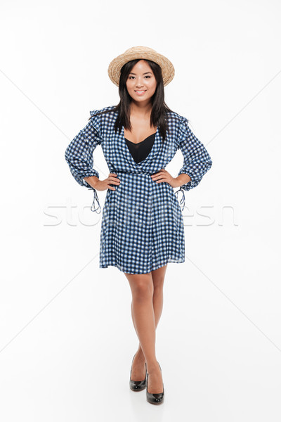 Stock photo: Full length portrait of a young asian woman in dress