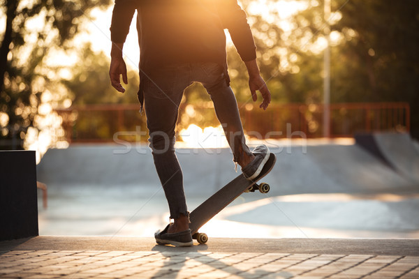 Young african man doing skateboarding outdoor Stock photo © deandrobot