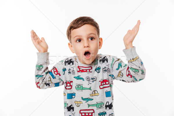 Portrait of a shocked little kid Stock photo © deandrobot