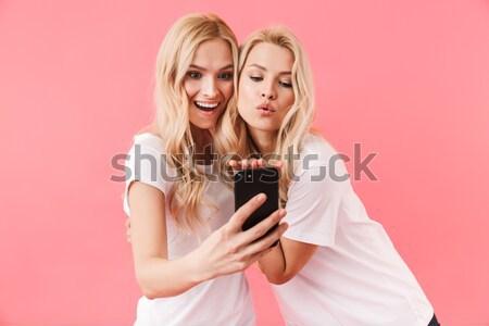 Funny zagęszczony damska patrząc smartphone inny Zdjęcia stock © deandrobot