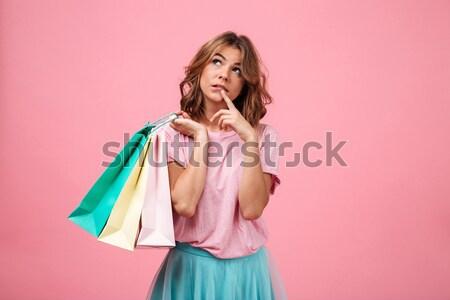 Sorpreso donna bionda pacchetti Foto d'archivio © deandrobot