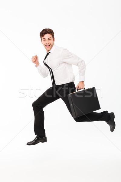 Full length portrait of a happy handsome businessman Stock photo © deandrobot