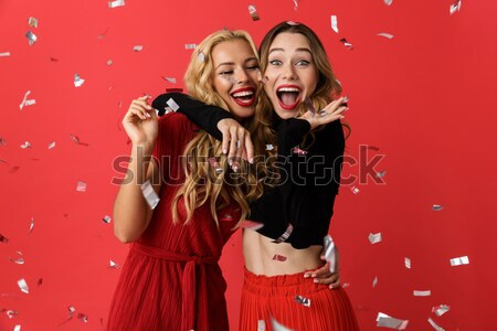 Shocked punk couple scatter popcorn and looking at the camera Stock photo © deandrobot