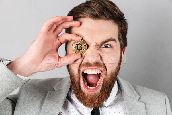 Close up of a screaming businessman Stock photo © deandrobot