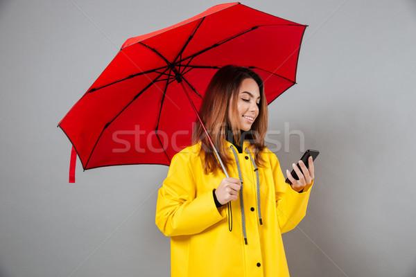 Portret glimlachend meisje regenjas permanente Stockfoto © deandrobot